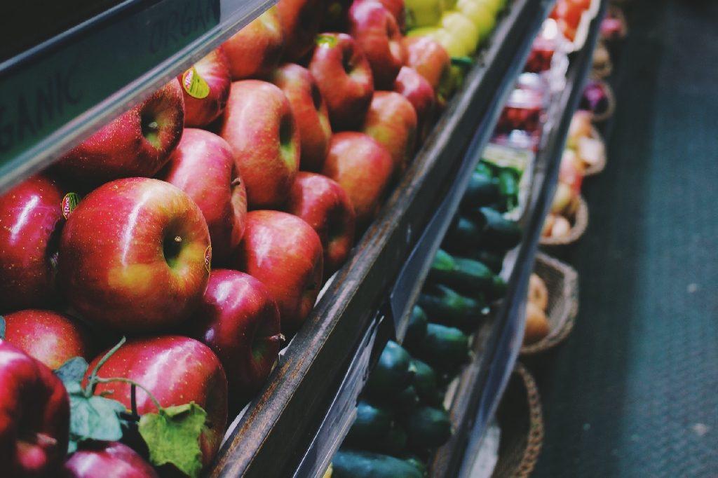 Apples in a supermarket  Photo by Alina Grubnyak on Unsplash