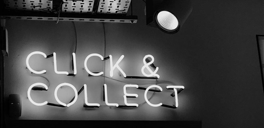 A 'Click & Collect' sign lit up Photo by Henrik Dønnestad on Unsplash