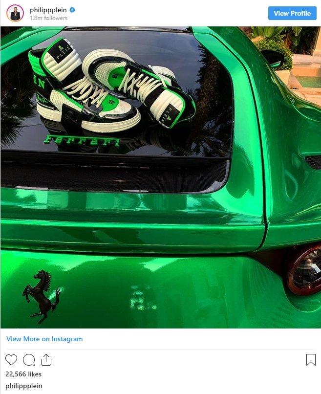 An Instagram post of a pair of Philipp Plein shoes on the bonnet of a Ferrari car